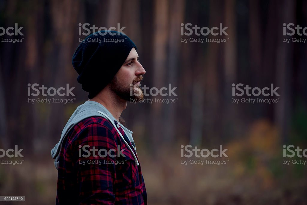 Portrait brutal bearded hipster man in the forest stock photo