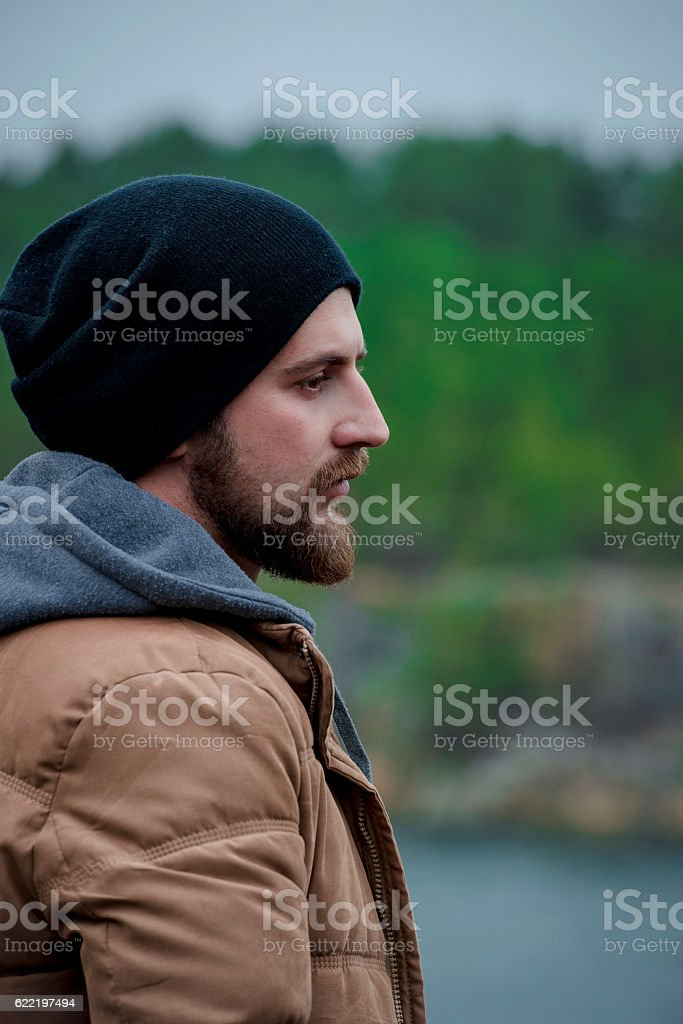 Portrait brutal bearded hipster man in the forest. royalty-free stock photo