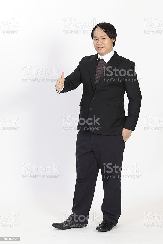 Portrait business man holding his thumbs up overwhite background stock photo