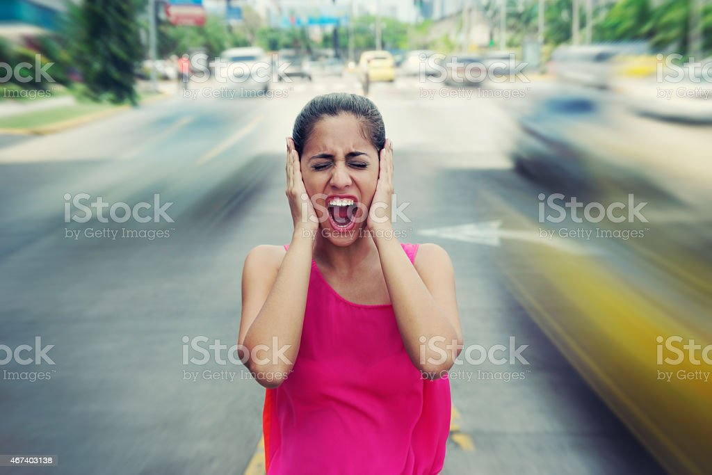Portrait business woman screaming at street car traffic stock photo