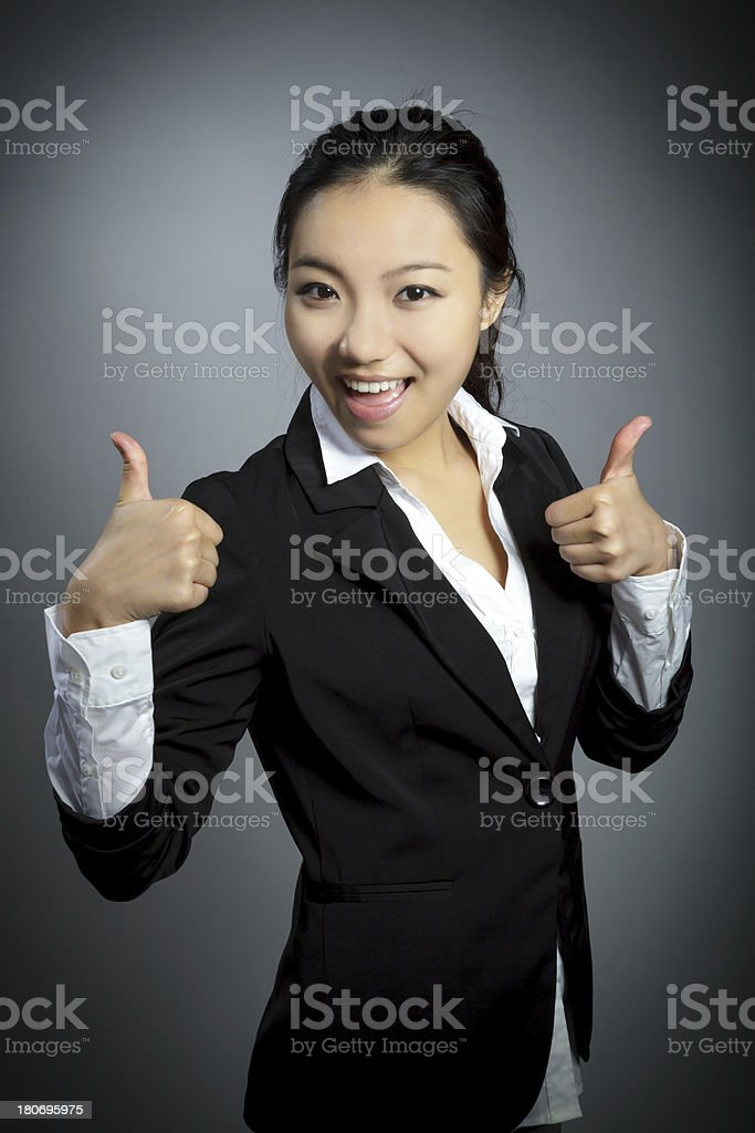 Portrait businesswoman attractive asian girl isolated on grey royalty-free stock photo