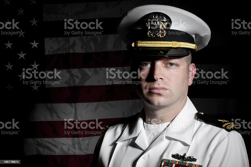 Portrait Caucasian Sailor Wearing White Uniform  American Flag Background stock photo