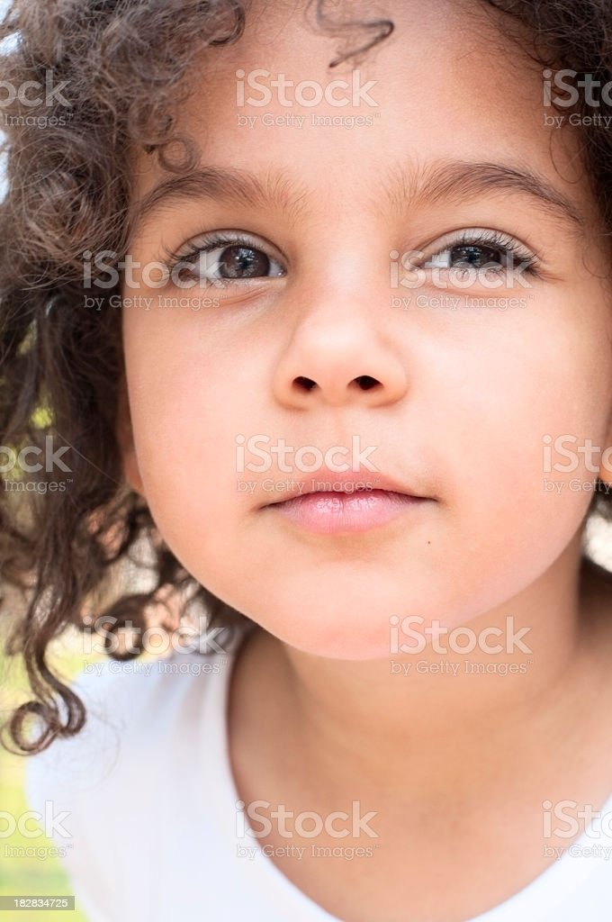 Portrait Child Smiling  with Wide Brown Eyes stock photo