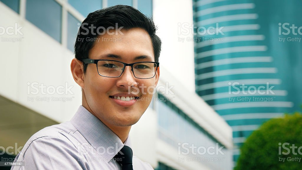 Portrait Chinese Businessman Smiling Outside Office Skyscraper stock photo