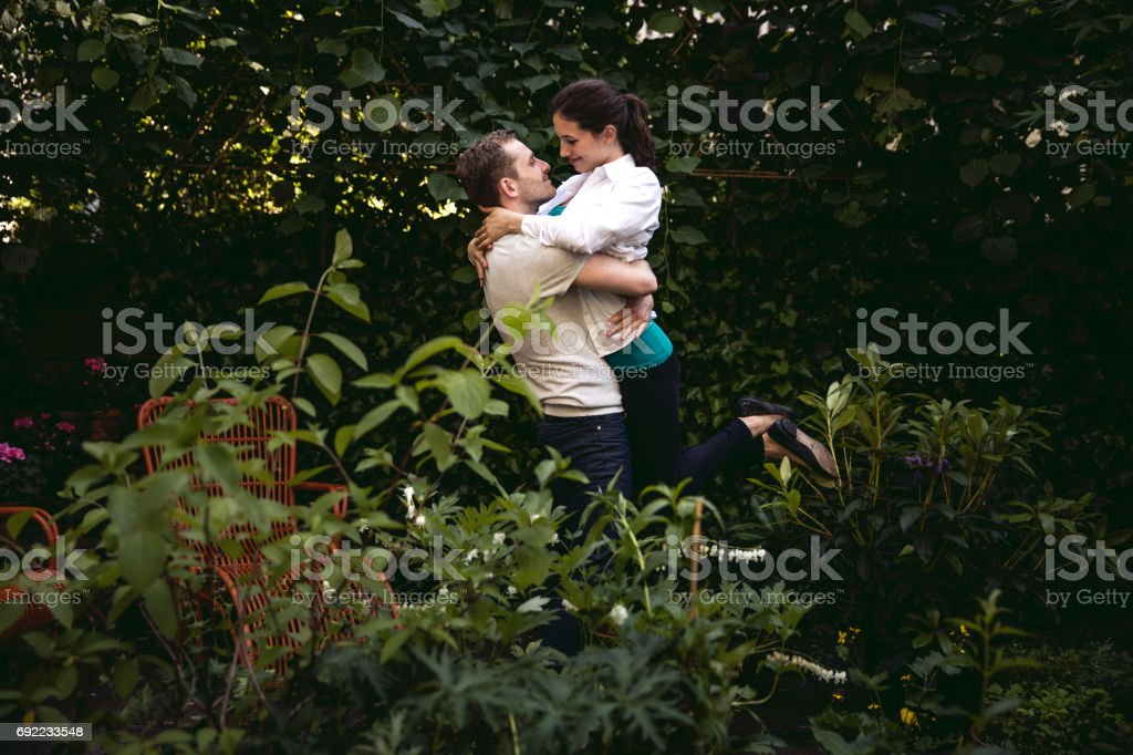 portrait couple in the house garden stock photo