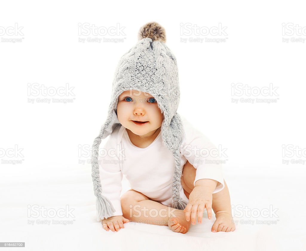 Portrait cute baby in grey knitted hat on white background stock photo