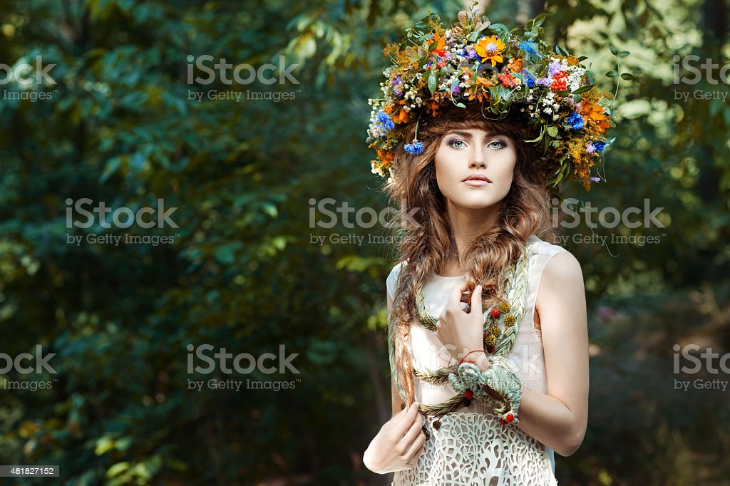 Portrait cute girl with wreath of flowers. stock photo