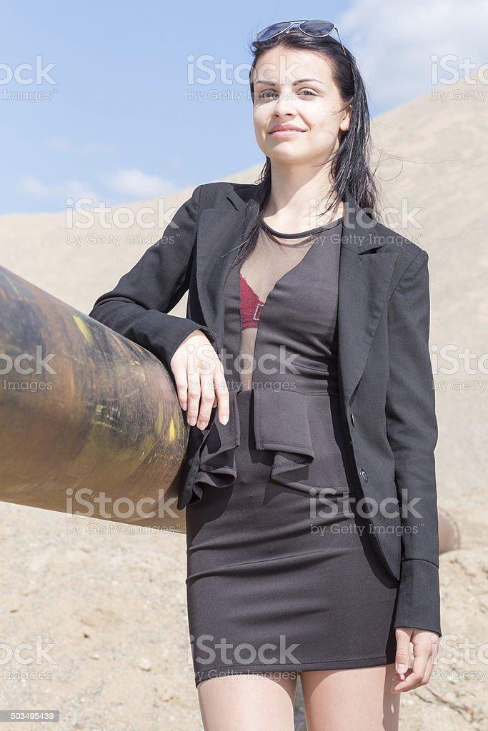 Portrait einer jungen Frau in wuestenartiger Landschaft stock photo