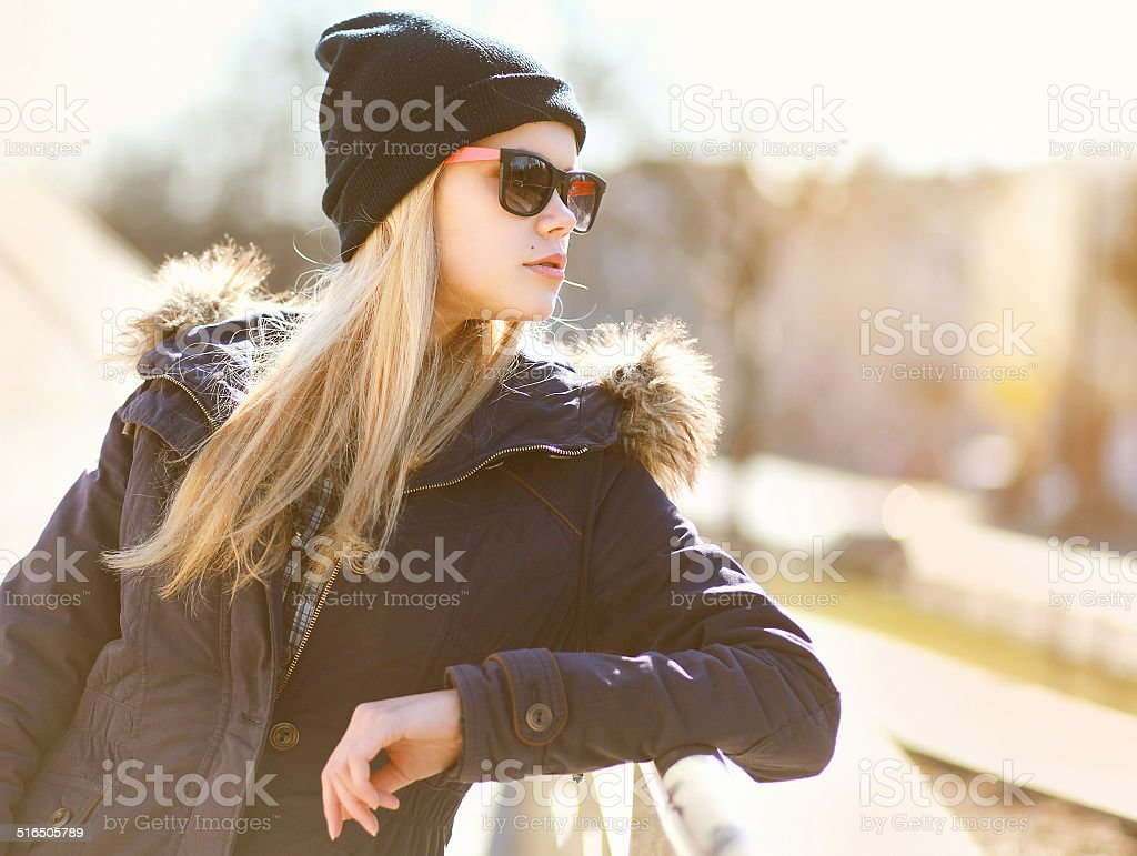 Portrait fashion hipster girl in the city in sunny day stock photo