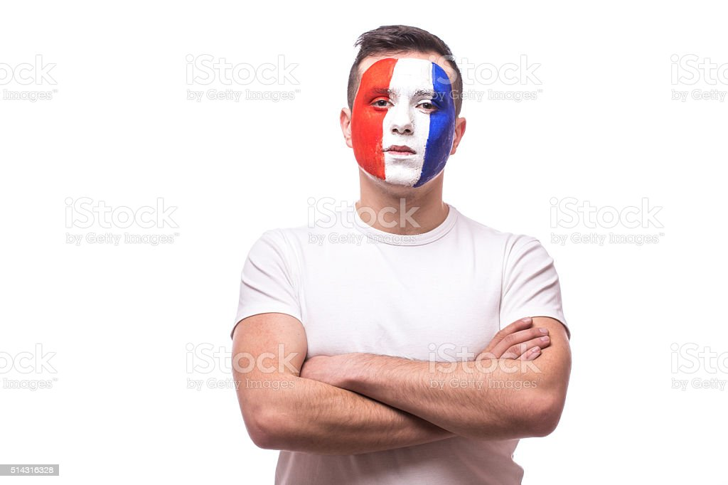 Portrait football fan confident without emotion France national football team. stock photo