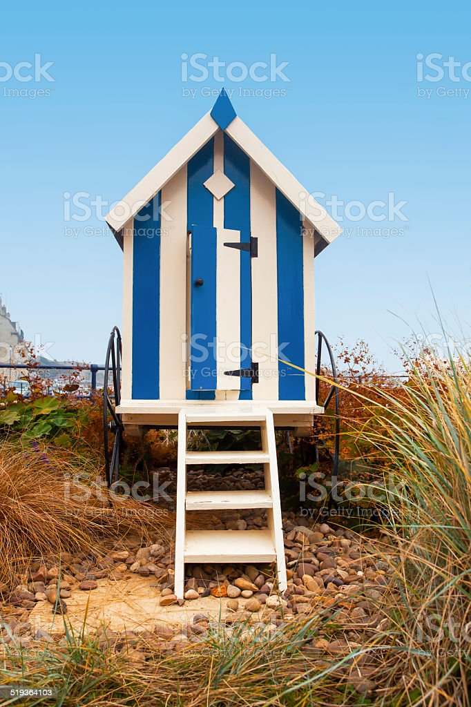 Portrait format blue striped beach hut with steps, Filey, UK stock photo