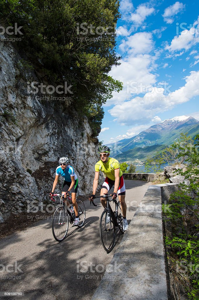 portrait format of two bikers on garda lake stock photo