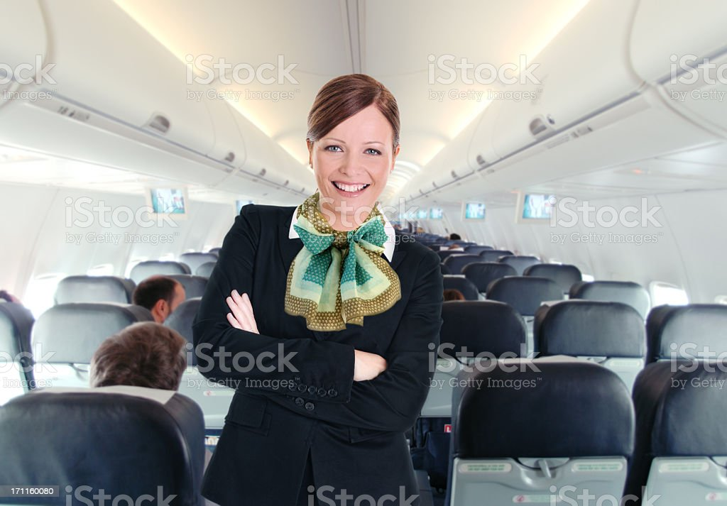 Portrait from a young beautiful flight attendant stock photo