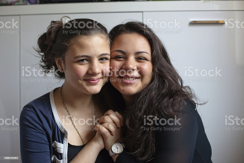 portrait from Hugging turkish teenage sisters, holding hands royalty-free stock photo