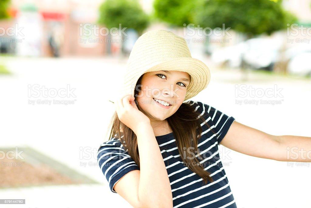 Portrait girl in bright hat stock photo
