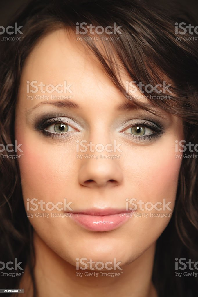 Portrait girl on brown. Woman with curly hair stock photo