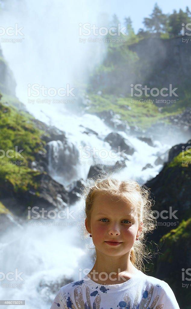 Portrait girl on summer waterfall background stock photo