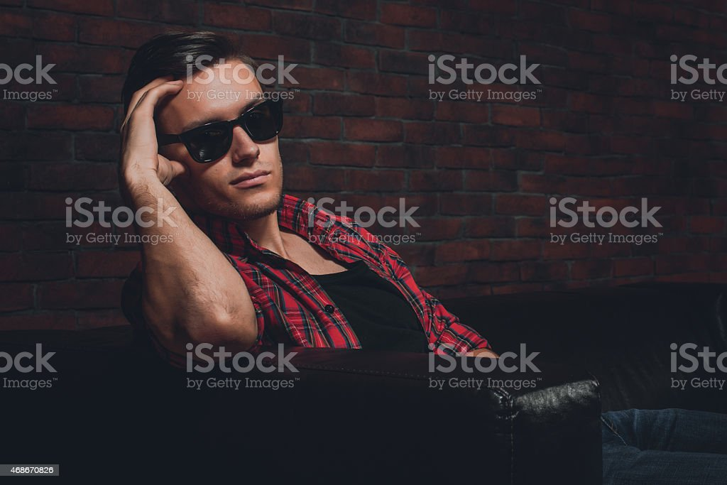 Portrait handsome young hipster man glasses casual clothes unbuttoned shirt stock photo