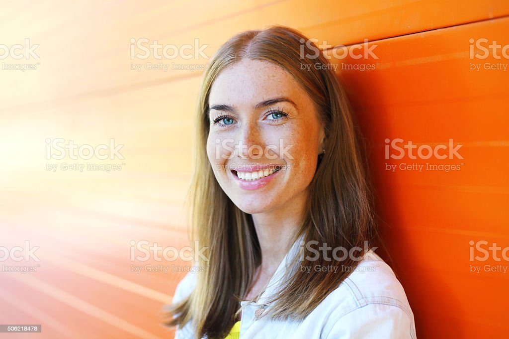 Portrait happy beautiful smiling woman closeup over colorful bac stock photo