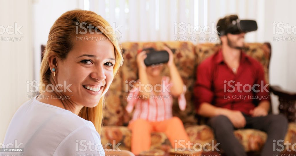 Portrait Happy Mother Smiling And Family Playing Virtual Reality stock photo