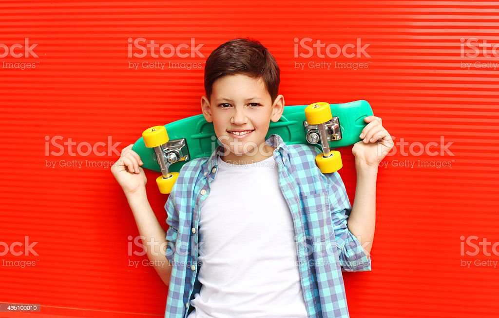Portrait happy smiling teenager boy wearing a checkered shirt wi stock photo