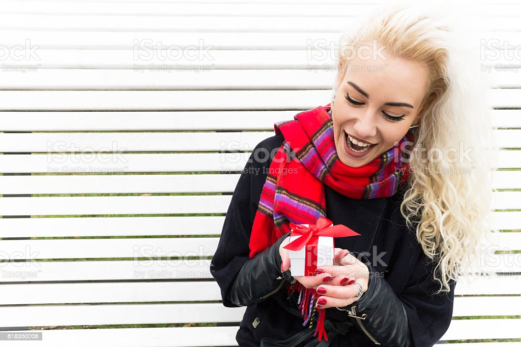 Portrait Happy Woman with Gift Box. Winter Concept stock photo