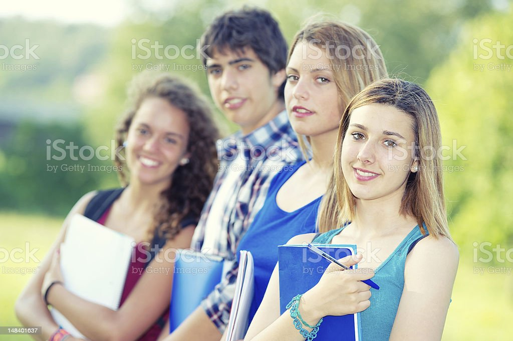 Portrait happy young students in park royalty-free stock photo
