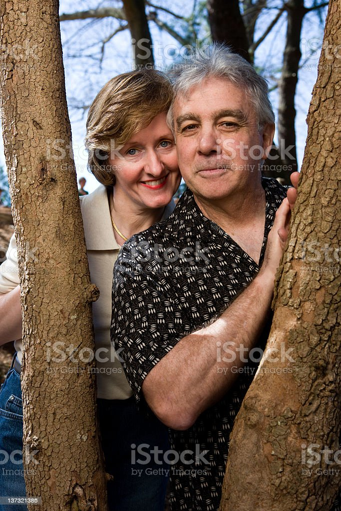 Portrait In The Park Of A Middle Aged Couple royalty-free stock photo