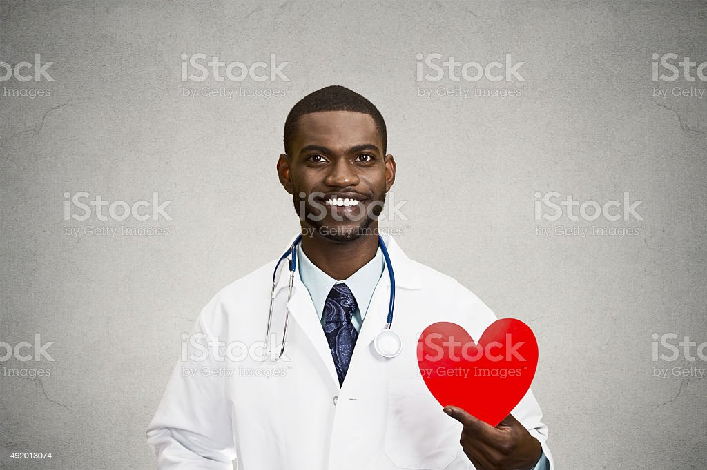Portrait male doctor holding red heart stock photo