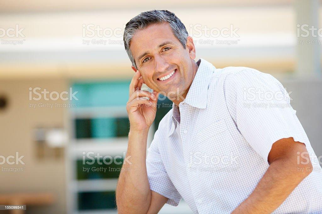 Portrait man sitting outdoors royalty-free stock photo