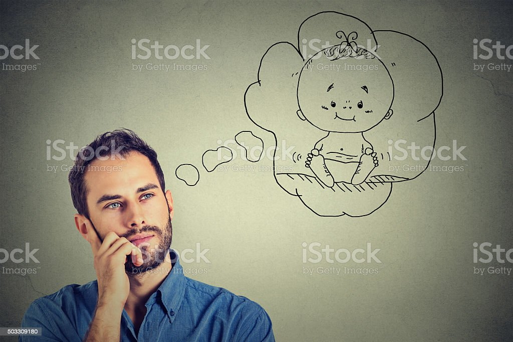 Portrait man thinking dreaming of a child stock photo