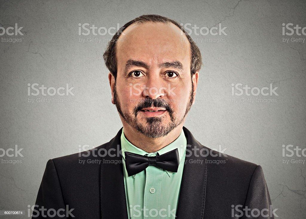 portrait mature gentleman wearing bow tie stock photo