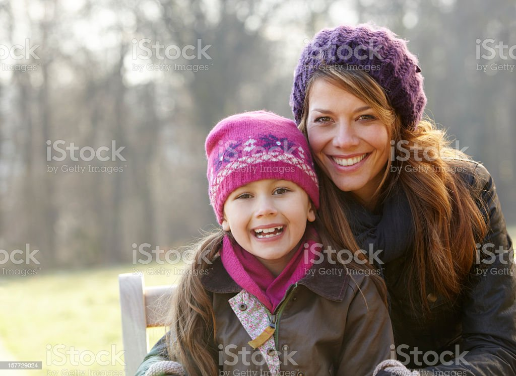 Portrait mother and daughter outdoors in winter royalty-free stock photo