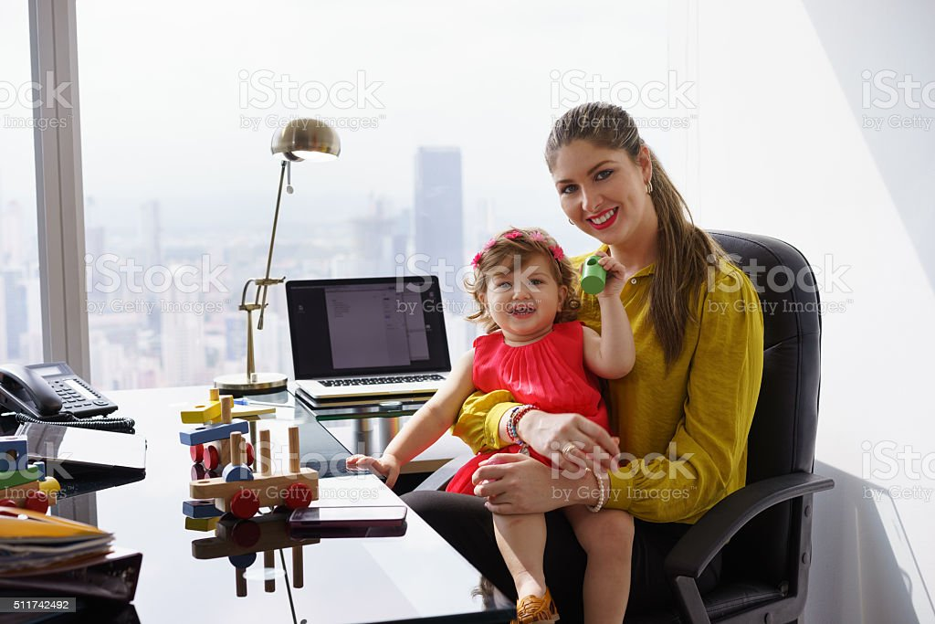Portrait Mother Business Woman Playing Child At Work stock photo