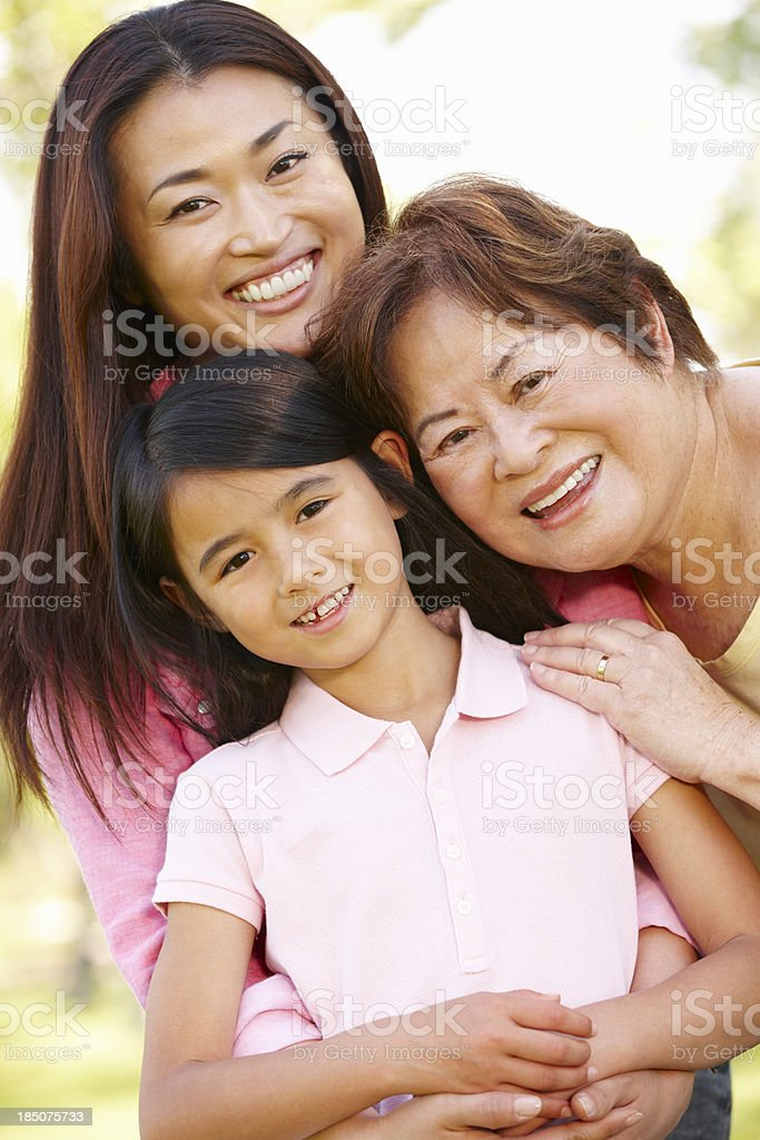 Portrait multi-generation Asian females in park royalty-free stock photo