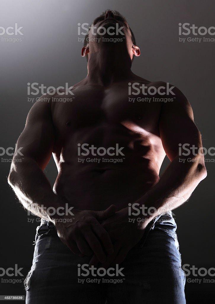 portrait muscular man on black background royalty-free stock photo