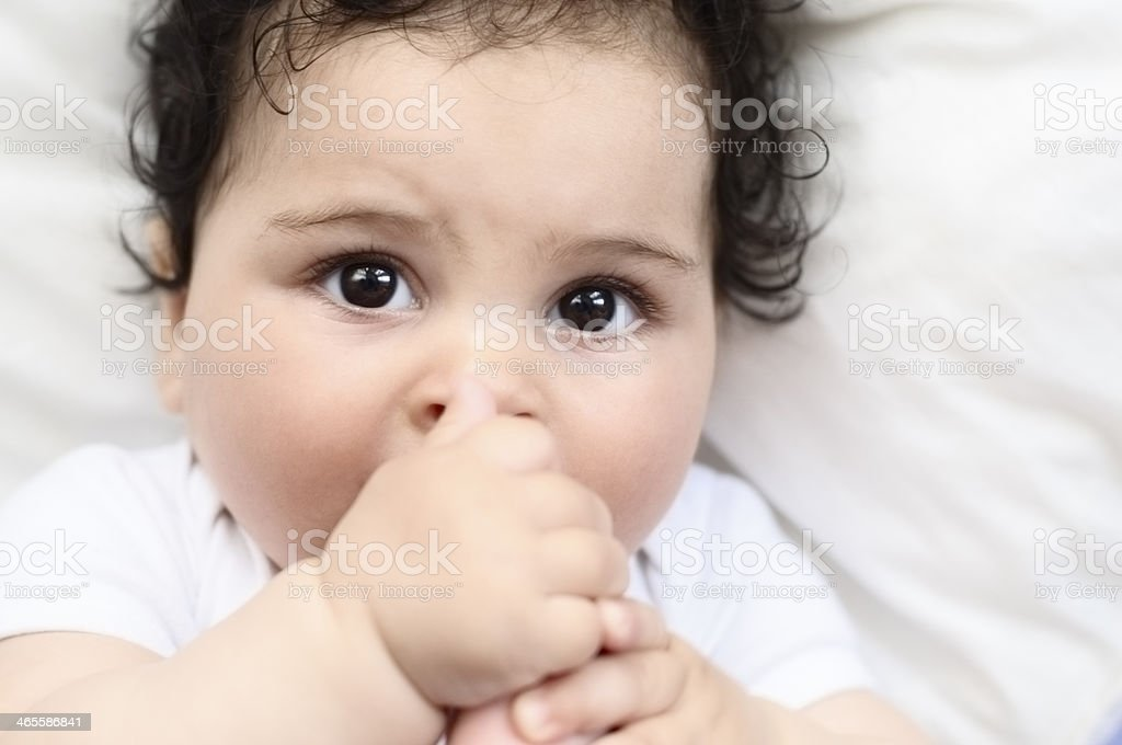 Portrait Of 6 Months Old Baby Girl Biting Her Toe royalty-free stock photo
