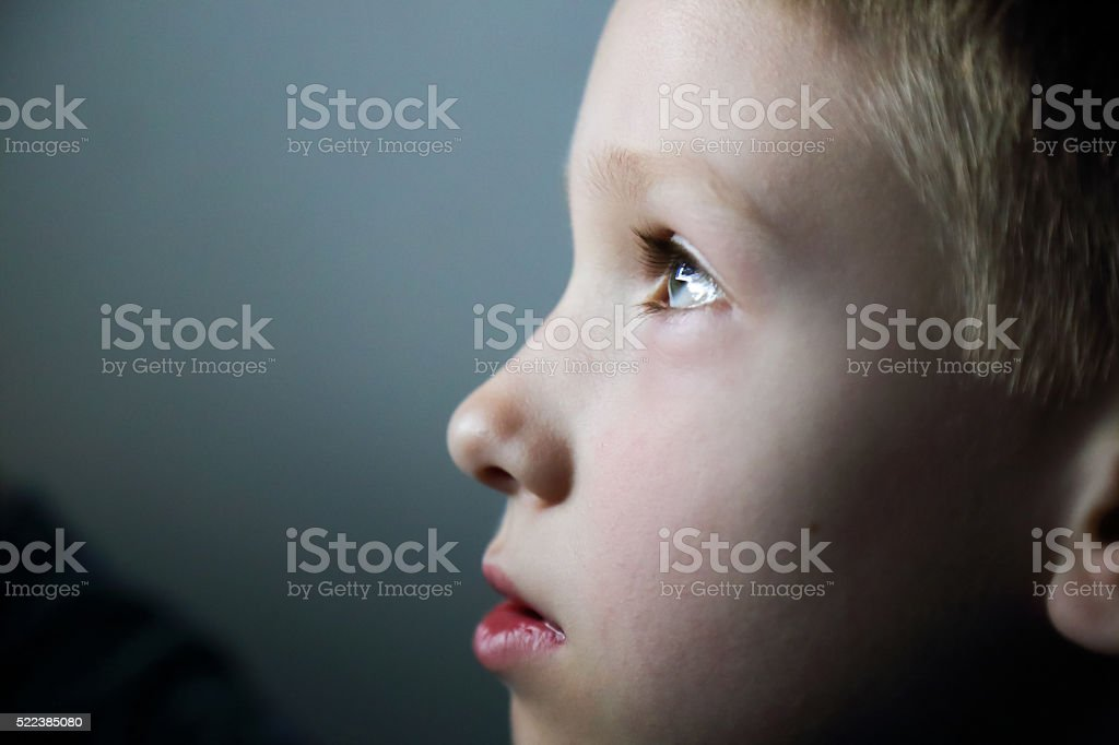 Portrait of 7 years old boy in front of screen stock photo