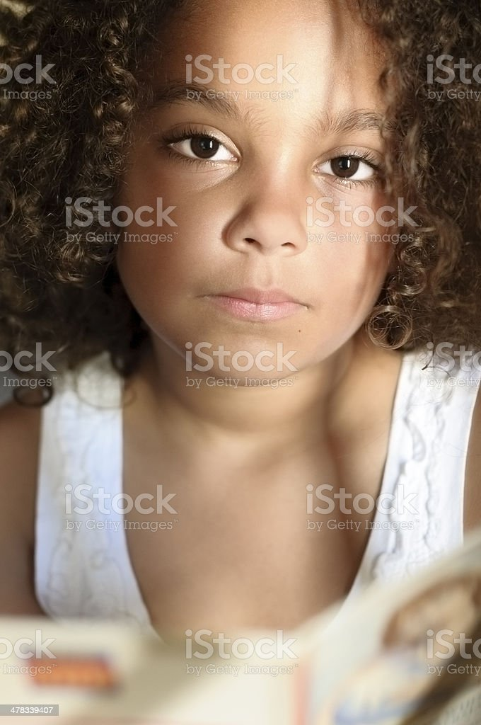 Portrait of 7 Years Old Girl Reading Book royalty-free stock photo