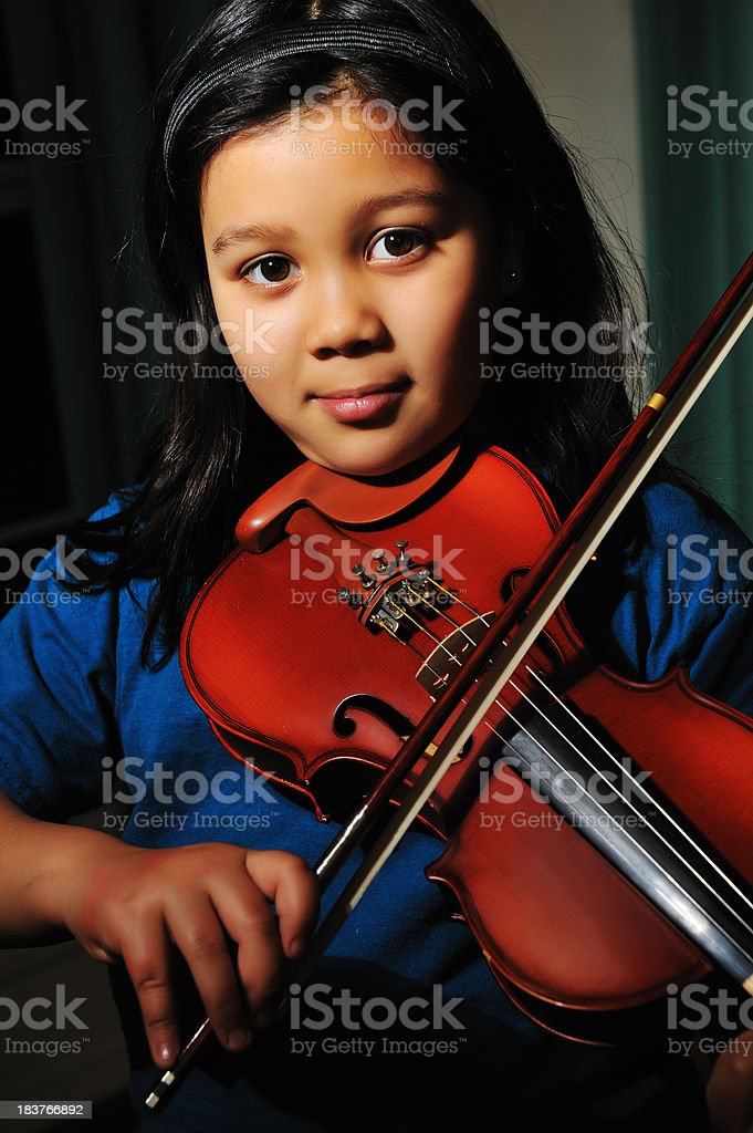 Portrait of 8 year old girl playing  violin stock photo