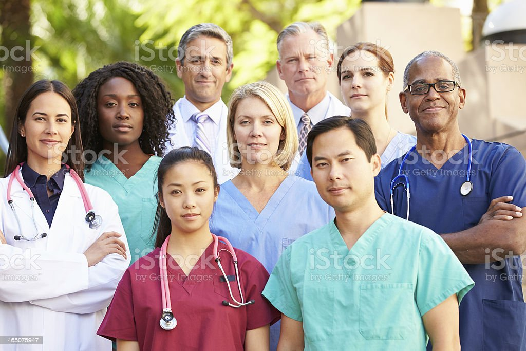 Portrait of 9 medical professionals stock photo