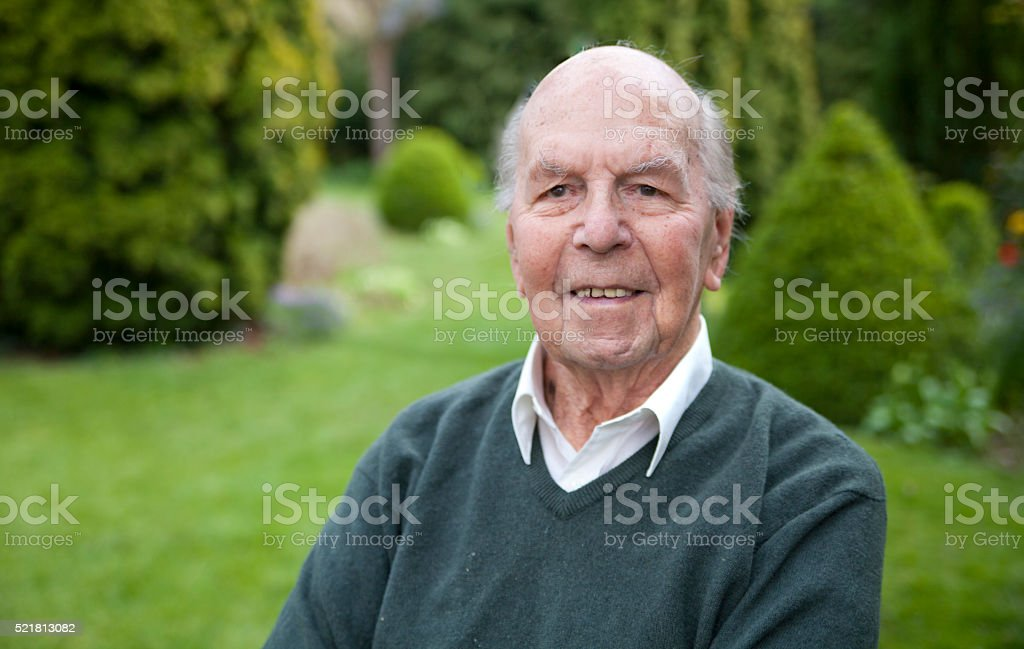 Portrait of 95 years old english man in his garden stock photo