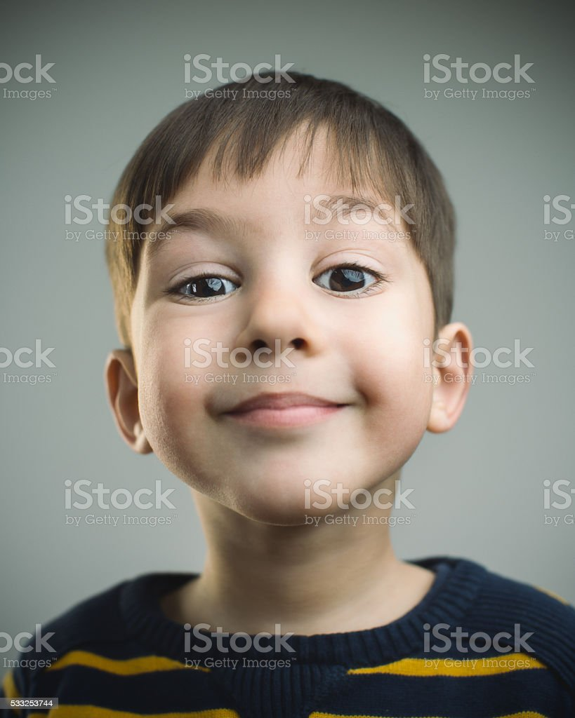 Portrait of a 4 years old boy with happy expression stock photo