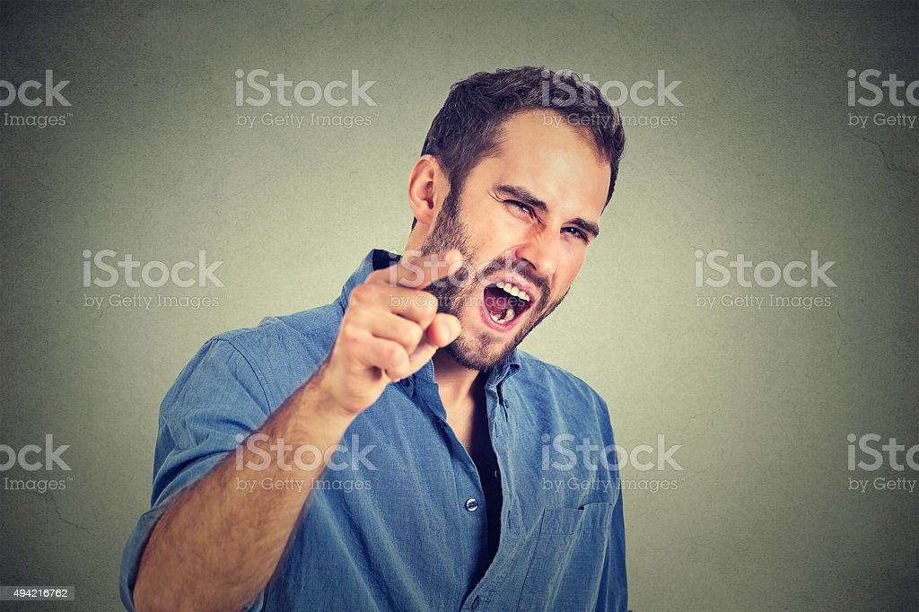 portrait of a angry young man stock photo