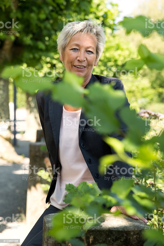 Portrait of a attractive business woman in the nature stock photo