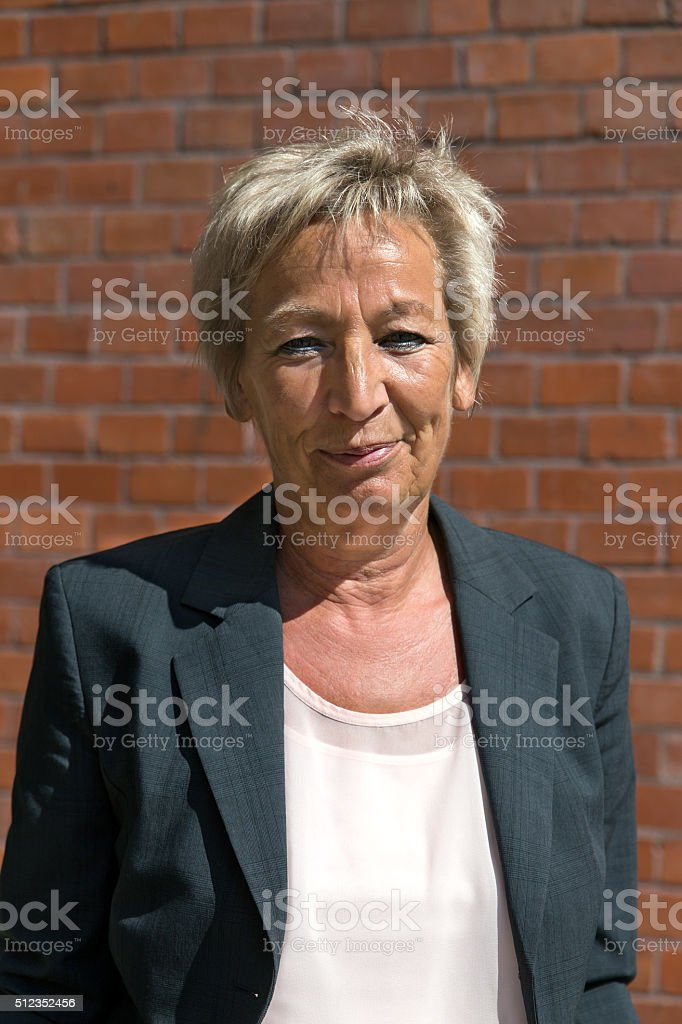 Portrait of a attractive older business woman stock photo