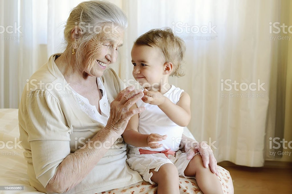 Portrait of a baby and great grandmother stock photo