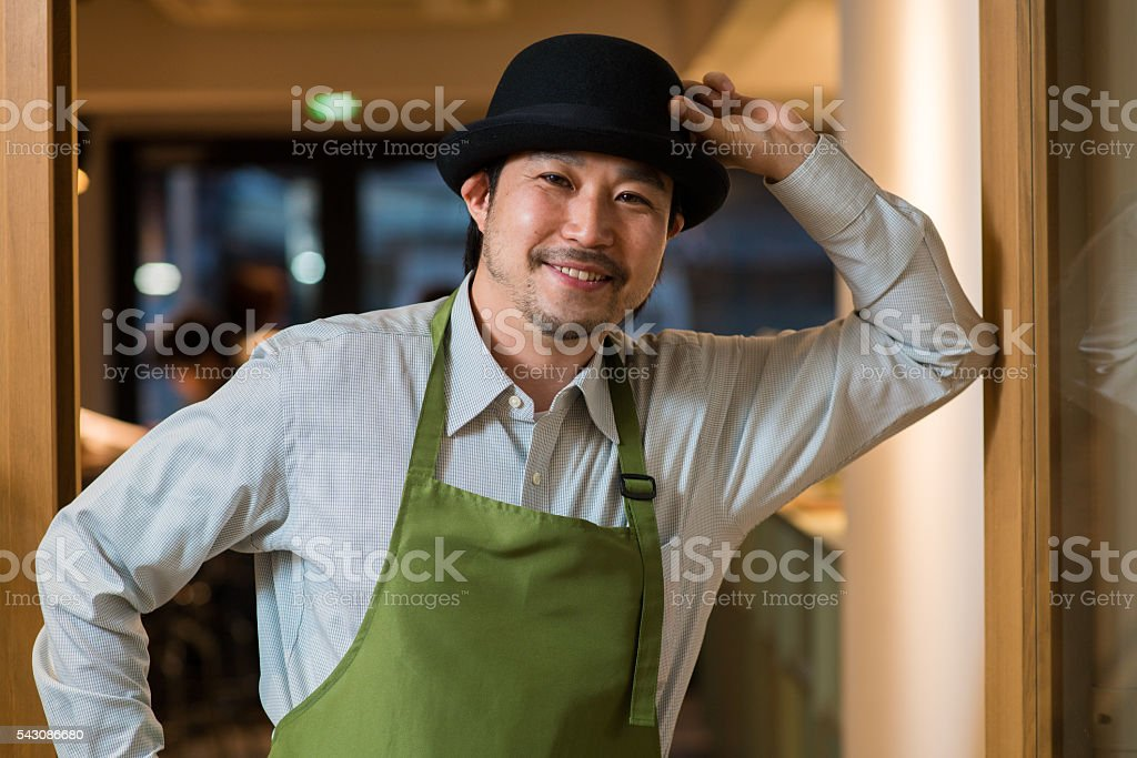 Portrait of a barista in an apron stock photo