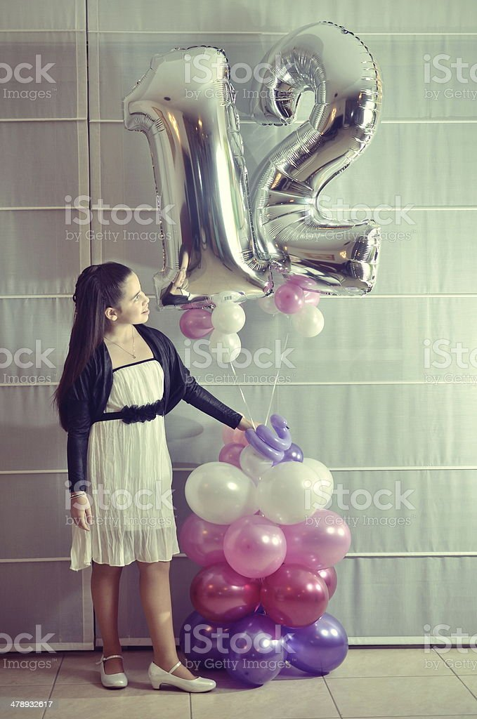 Portrait of a Bat Mitzvah girl with baloons (Vintage Processed) stock photo