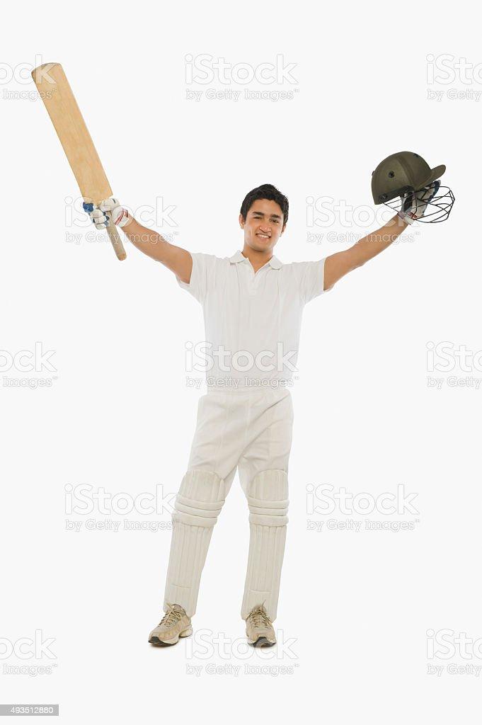 Portrait of a batsman celebrating his success stock photo
